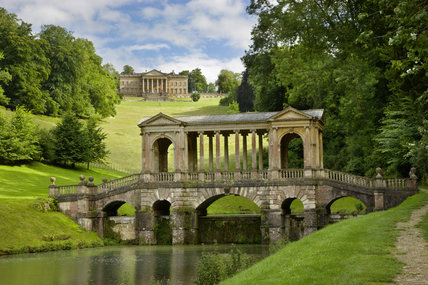 The Palladian Bridge, and house (not owned by the NT) in the distance, at Prior Park Landscape Garden, Bath