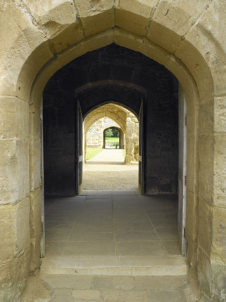 View through the arched doorways from the Gatehouse to the Postern Tower at Bodiam Castle, East Sussex, built between 1385 and 1388
