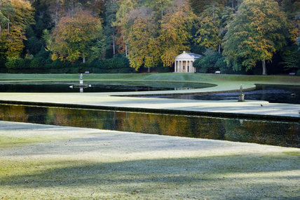 The Temple of Piety with pediment and Tuscan columns, seen over the Canal and Half-Moon pond, at Studley Royal Water Garden, North Yorkshire