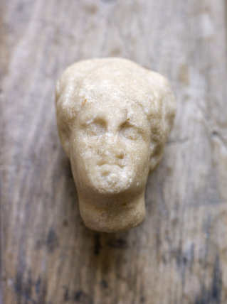 Roman marble head of a lady, found in a field on the Kingston Lacy estate, Dorset by a National Trust warden
