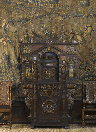 The pedimented French cabinet in carved and partly gilded walnut, dating from around 1580, in the Withdrawing Chamber at Hardwick Hall, Derbyshire