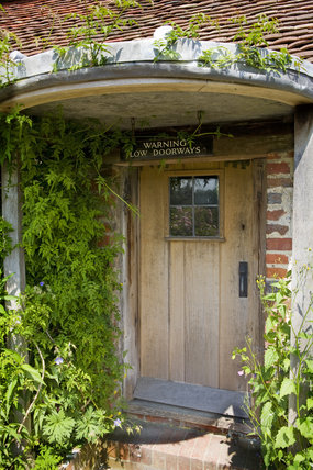 Pretty wooden door, with a warning sign, at Alfriston Clergy House in East Sussex