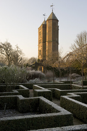The Elizabethan Tower and the White Garden in the foreground in winter at Sissinghurst Castle Garden, near Cranbrook, Kent