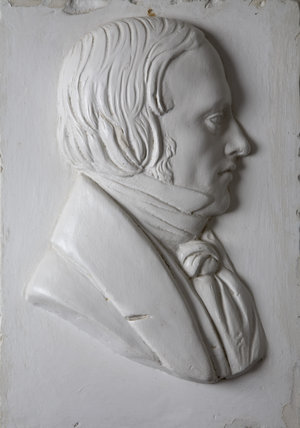 A relief portrait of Sir John Palmer Bruce Chichester, Bart. JP, MP (1794-1851) in the Entrance Hall at Arlington Court, Devon.