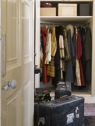 Period clothes and luggage in the Dressing Room at Greenway, Devon, which was the holiday home of the crime writer Agatha Christie