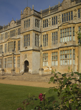 The east front with projecting bay and porch at Montacute House, Somerset