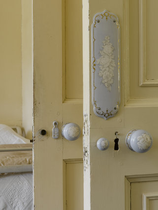 Decorative fingerplate, knob and escutcheon on Agatha Christie's Bedroom door at Greenway, Devon, which was the holiday home of the crime writer Agatha Christie between 1938 and 1976