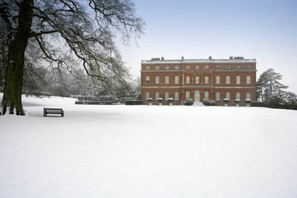 Snow carpets the parkland in front of Clandon Park, Guildford, Surrey