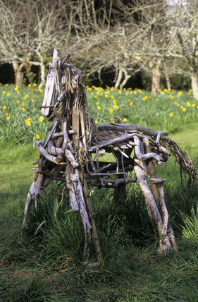 A driftwood sculpture of a horse, in the gardens at Cotehele, Cornwall