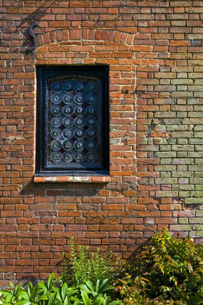 Window and brickwork of the eighteenth-century Stables at Baddesley Clinton, Warwickshire