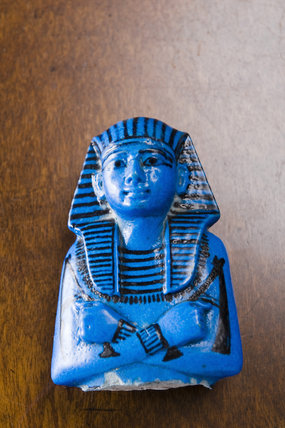 Blue-coloured Royal Shabti of King Sethos I from ancient Egyptian burial site, part of William Bankes's collection in the Egyptian Room at Kingston Lacy, Dorset