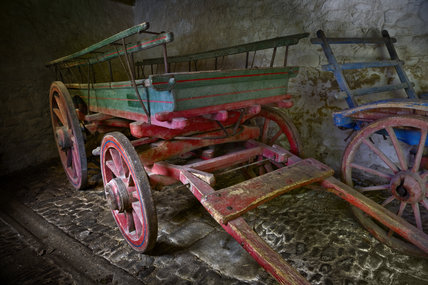 An old farm cart in one of the outbuildings at Godolphin House, once the home of Queen Anne's Lord High Treasurer, Sidney Godolphin, near Helston, Cornwall
