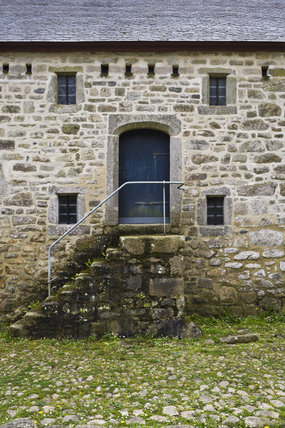 Steps to the door of an old farm building on the estate of Godolphin House,  near Helston, Cornwall