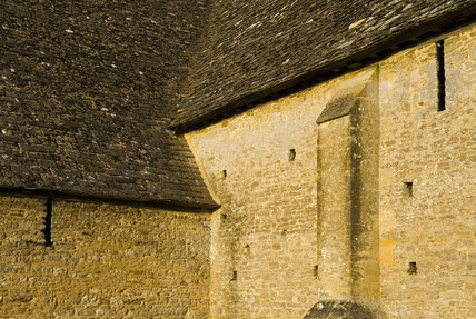 Close view of one of the stone buttresses on the mid-thirteenth century monastic Great Coxwell Barn near Faringdon in Oxfordshire