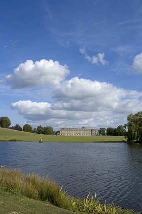 The west front of the late seventeenth-century Petworth House seen across the lake and park