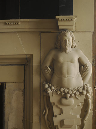 Close view of one of the carved stone figures on either side of the fireplace in Lady Shrewsbury's Bedchamber at Hardwick Hall, Derbyshire