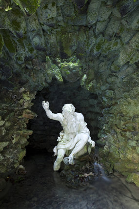 Statue of the River God in painted lead by John Cheere in the River God's Cave which faces the exit of the Grotto at Stourhead, Wiltshire