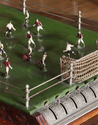 A table football game, probably German, made about 1900, in the Library at Castle Drogo, Devon