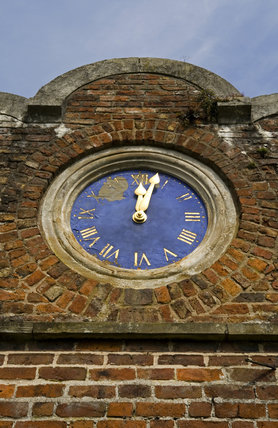 The cusped gable wall and clock brought from Stansty Park, at Erddig, Wrexham, Wales