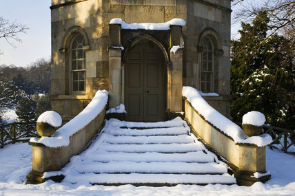 Steps to the Octagon Tower under snow on the valley side at Studley Royal Water Gardens, North Yorkshire
