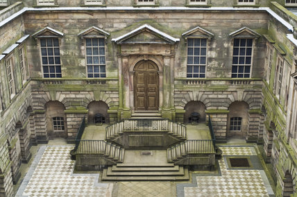 The Palladian courtyard at Lyme Park, Cheshire, designed by Italian architect Giacomo Leoni and built 1727-1734, with chequered paving added in the early C20th