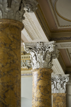 The scagliola columns, made to represent Sienna marble, of the Staircase Hall at first floor level, at Berrington Hall, Herefordshire