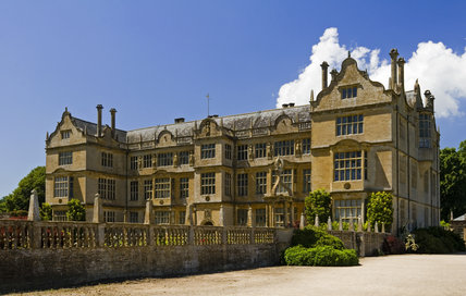 The east front of Montacute House, Somerset with the balustraded wall of the East Court garden