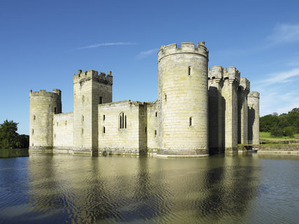 A view across the moat to the East and North Ranges of Bodiam Castle, East Sussex, built between 1385 and 1388