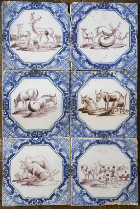 Blue and white Dutch tiles with cattle, deer and hound motifs at Baddesley Clinton, West Midlands