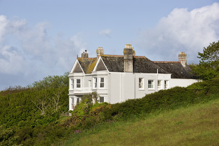 Broom Parc perched on the clifftop at Veryan, near Truro, Cornwall, a National Trust bed & breakfast establishment