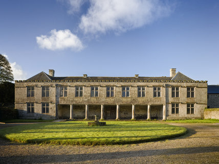 The north front with the portico of Godolphin House, once the home of Queen Anne's Lord High Treasurer, Sidney Godolphin, near Helston, Cornwall