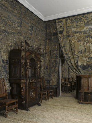 The French cabinet in carved and partly gilded walnut, dating from around 1580, in the Withdrawing Chamber at Hardwick Hall, Derbyshire