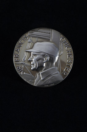 The medal commemorating Sir Francis Chichester's circumnavigation of the world in 1966-7, in the Morning Room at Arlington Court, Devon