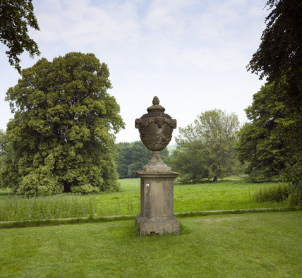 Ornamental eighteenth-century urn on a plinth at the northern end of the garden, overlooking the 32 hectares of parkland at Hinton Ampner, Hampshire