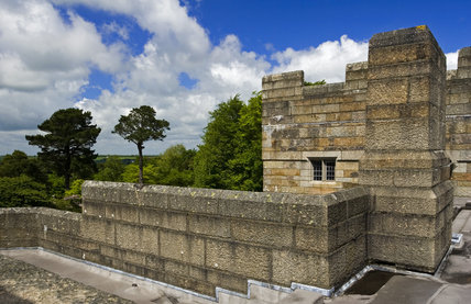 View across the roof towards the surrounding Dartmoor countryside at Castle Drogo, Devon