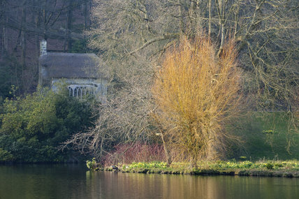 The Gothic Cottage and lake at Stourhead, Wiltshire, in March