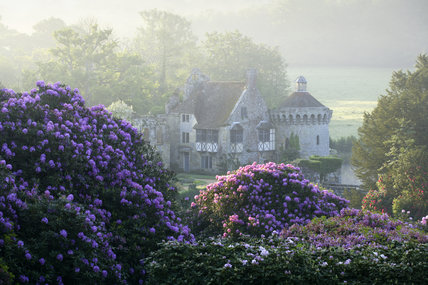 The ruins of the fourteenth-century moated Scotney Castle, Lamberhurst, Kent, set amidst beautiful gardens