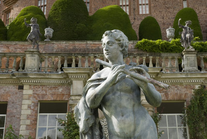 C18th lead statue of a shepherd by John Van Nost on the terraced garden at Powis Castle, Powys, Wales
