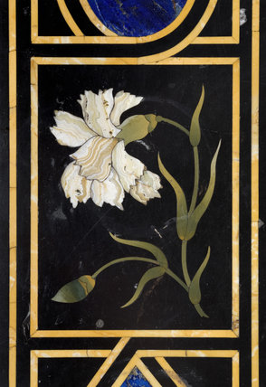 A panel with a floral motif from the pietra dura table in the Entrance Hall at Hinton Ampner, Hampshire