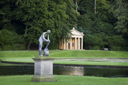 The statue of Galen in front of the Temple of Piety at Studley Royal Water Garden, North Yorkshire