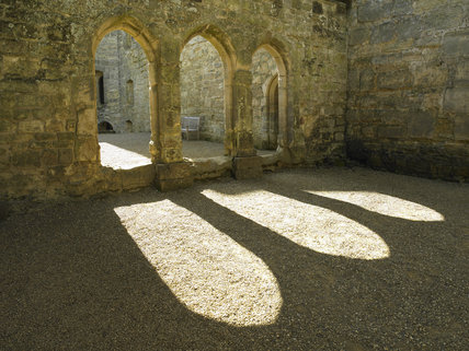 The three arches of the Screens Passage which connects the Great Hall to the Kitchen, Pantry and Buttery at Bodiam Castle, East Sussex, built between 1385 and 1388