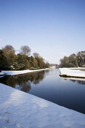 Looking along the Canal, with snow, at Studley Royal Water Garden, North Yorkshire