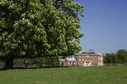 Long view of the house and garden at Hatchlands Park, Guildford, Surrey