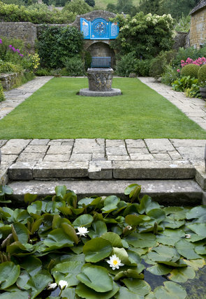 The Lily Pool in the Well Court with the Venetian well-head at Snowshill Manor, Gloucestershire