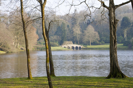 The lake at Stourhead, Wiltshire, with the Palladian Bridge in the distance, in March