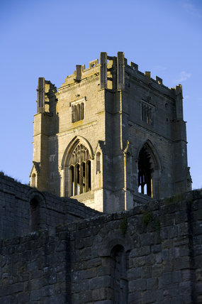 The sixteenth-century Abbot Marmaduke Huby's tower above the west end of the nave at Fountains Abbey, North Yorkshire