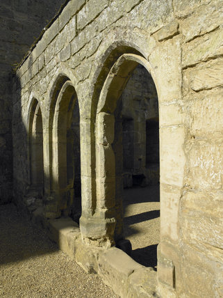 The three arches of the Screens Passge which connected the Great Hall to the Kitchen, Buttery and Pantry at Bodiam Castle, East Sussex, built between 1385 and 1388