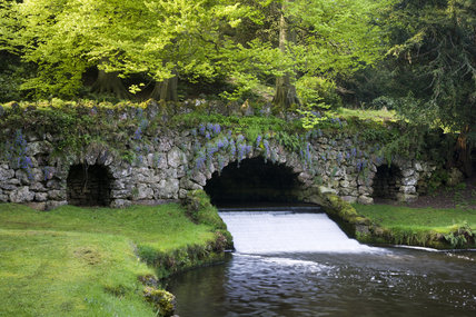 The Rustic Bridge over the River Skell at Studley Royal Water Garden, adjoining the estate at Fountains Abbey, North Yorkshire