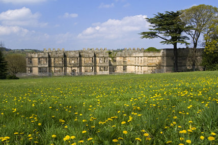 View across a wildflower meadow towards the Hall built between 1603 and 1620, with alterations in both the 18th and 19th centuries, at Gibside, Newcastle upon Tyne