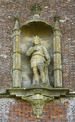 Close view of the statue of King Alfred in a niche in the triangular Alfred's Tower at Stourhead, on Kingsettle Hill, two miles north- west of the garden on the spot where King Alfred raised his standard in 879